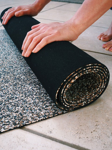 Rolling up Zen TribeUK Yoga Mat amde from Cork and Recycled Plastics